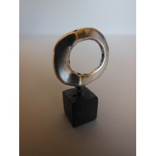 Silver Ring on Black Wood Base