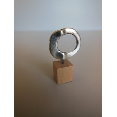 Silver Ring on Wood Base