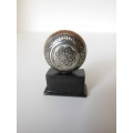 Round Metal Sculpture on Rectangle Black Base