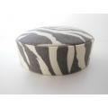 Zebra Print Round Ottoman in Gray/Cream